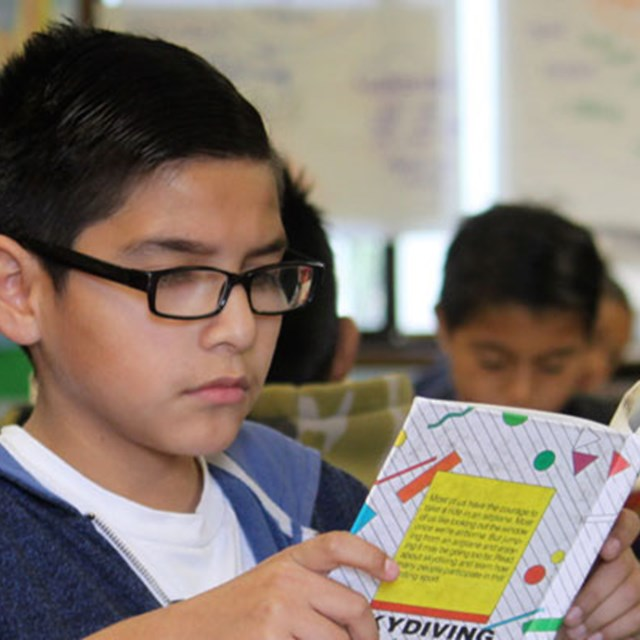 Scholars explore different worlds through reading.