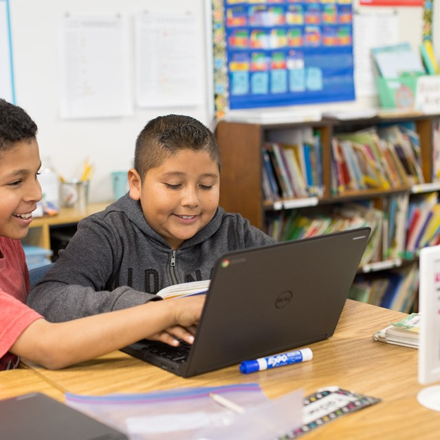 These two gentlemen explore the world of technology as they collaborate on a digital project.