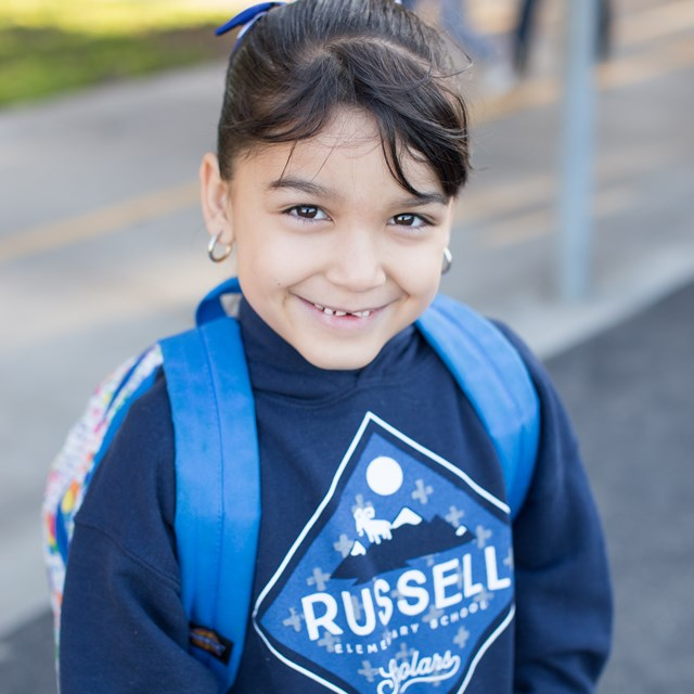 Our students are proud to show off their school spirit with their Russell shirts.